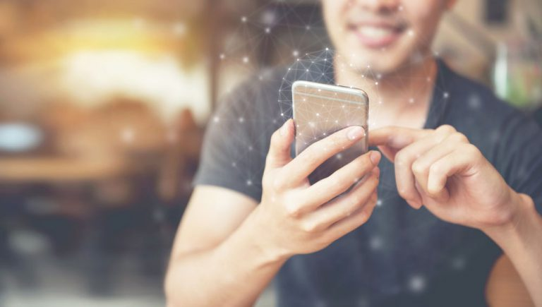 smiling customer engagement on mobile symbolizing customer service goals and objectives being accomplished