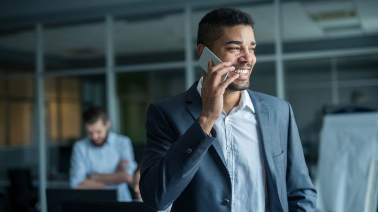 Person smiling talking on phone
