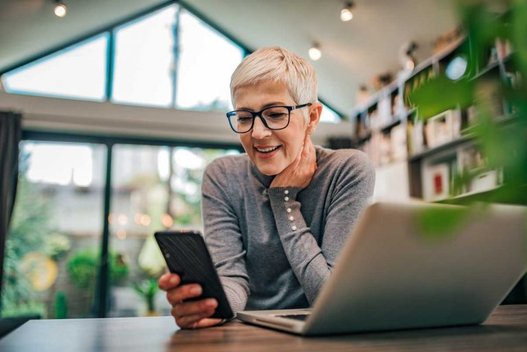 woman smiling at email reply illustrating building customer loyalty with email automation